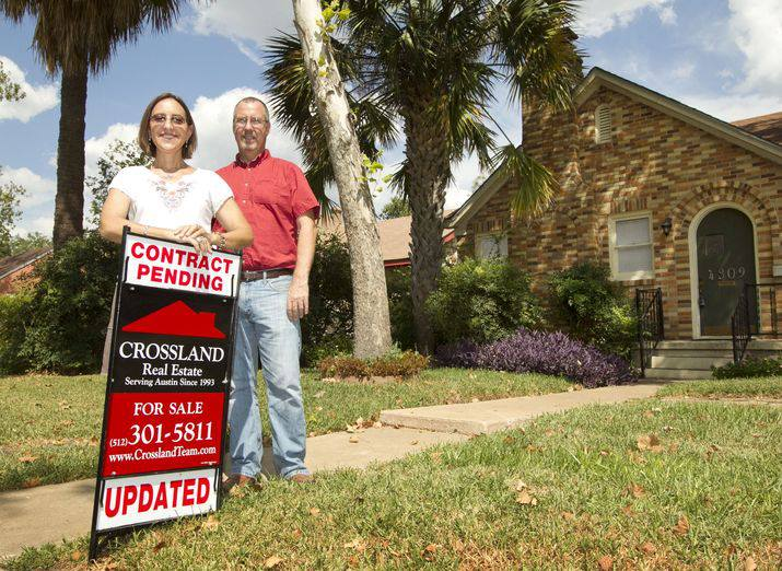 Photo of Steve and Sylvia Crossland in front of Central Austin listing
